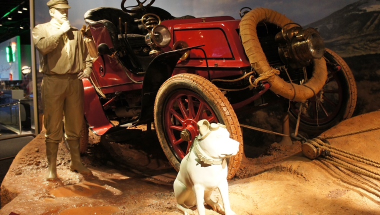 A museum display of the old Winton car that made the trip with a model of Jackson and Bud the dog.