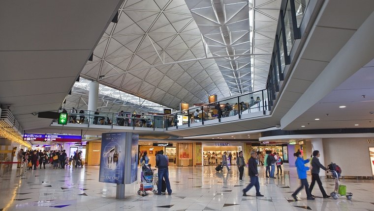 Travelers rush around Hong Kong International Airport.