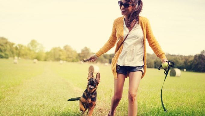 woman runs with puppy
