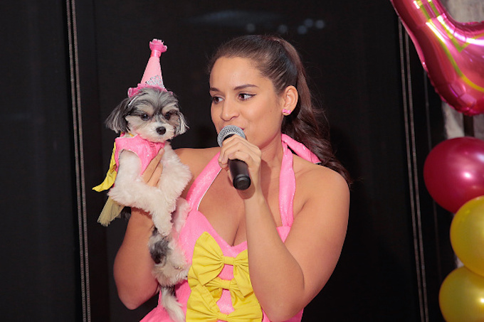NEW YORK, NY - NOVEMBER 11: Actress and Singer Gina Naomi Baez sings to Tinkerbelle during the Andi Dorfman Celebrates Tinkerbelle The Dog's Birthday at Inglot Cosmetics on November 11, 2015 in New York City. (Photo by Randy Brooke/Getty Images)