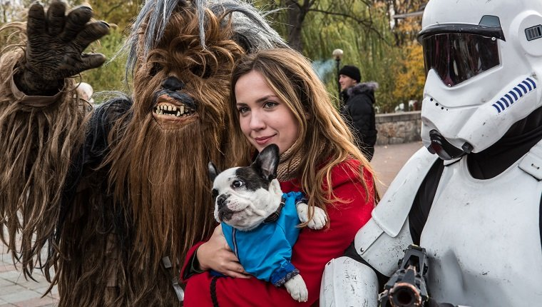 KIEV, UKRAINE - OCTOBER 24: A woman and her dog pose for a picture with representatives of the Internet Party of Ukraine dressed as characters from Star Wars, including parliamentary candidate Stepan Mikhailovich Chewbacca (L), on October 24, 2014 in Kiev, Ukraine. The country's parliamentary elections, scheduled for Sunday, are seen as key to President Petro Poroshenko's ability to advance his agenda, stabilize the economy, and end fighting in the country's east.