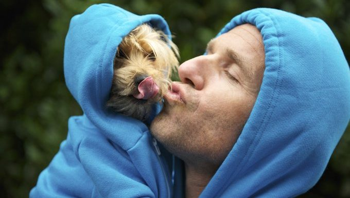 puppy licks owner in matching hoodie