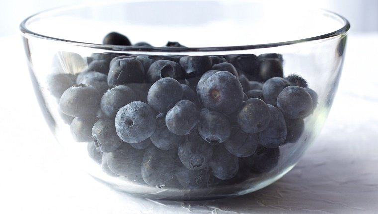 Close-Up Of Delicious Blueberries In Glass Bowl