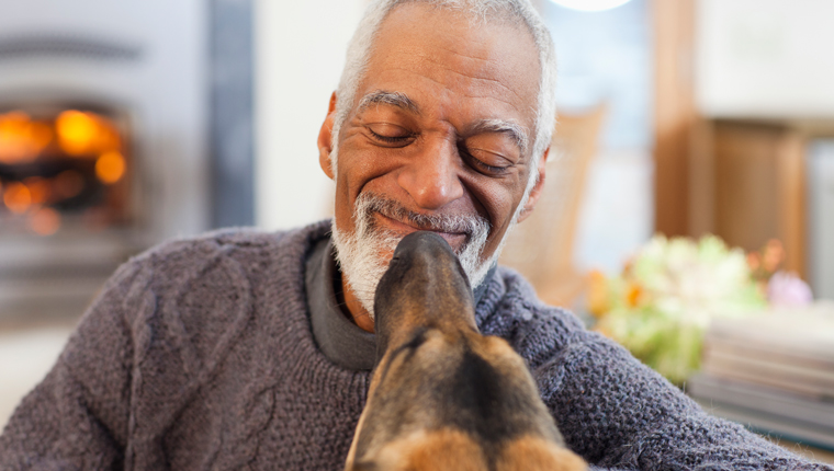 man smiling at dog